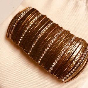 Rose gold toned cuff bracelet with rhinestones